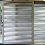 Adjustable louvered interior doors transmit sun rays
