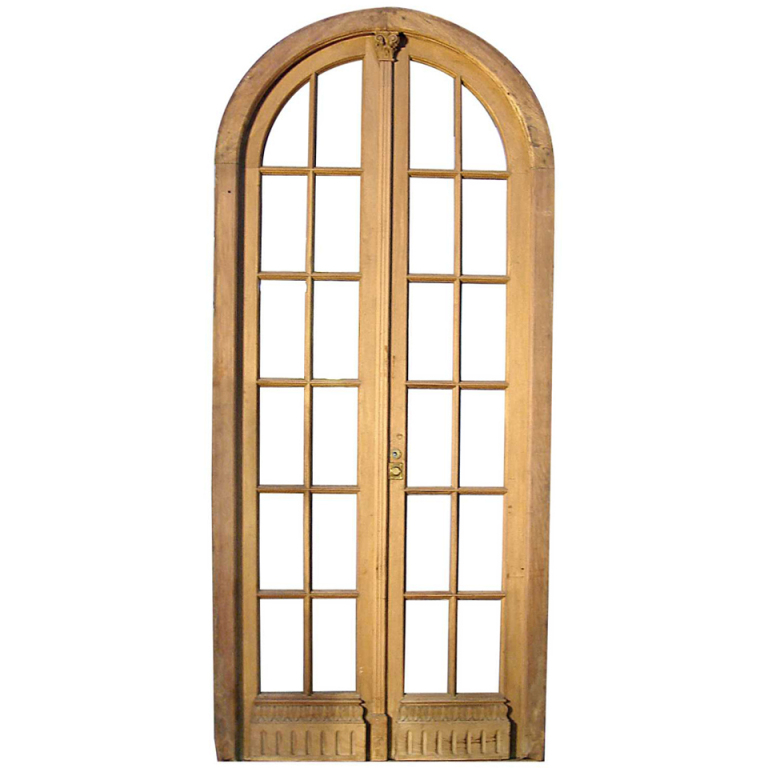 Arched entry doors with glass is the best piece of furniture