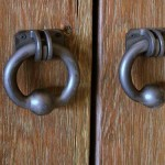 : Barn door hardware pulls are made from metal