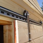 : Barn door hardware rollers help the door sliding easily