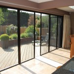 : Bi fold patio doors with screens look great and save from too intense sunshine