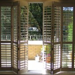 : Bi folding exterior doors with blinds are often installed in rural houses