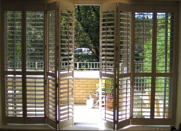Bi folding exterior doors with blinds are often installed in rural houses