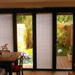 : Bifold patio doors with blinds are convenient and weather protective
