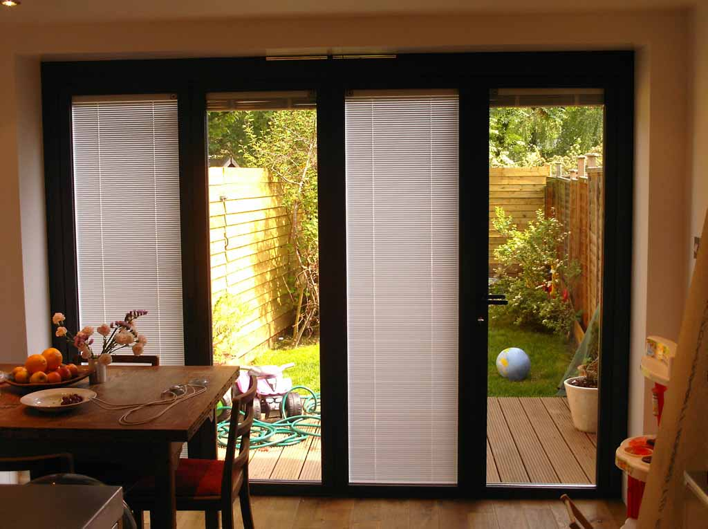 Bifold patio doors with blinds are convenient and weather protective