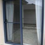 : Commercial sliding doors exterior is likely to be made of glass
