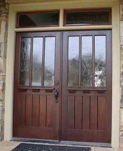 craftsman style double entry doors allow us to make any place look