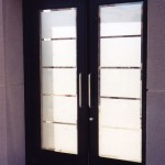 : Decorative etched glass interior doors are contemporary