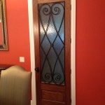 : Decorative wrought iron interior doors have dramatic style