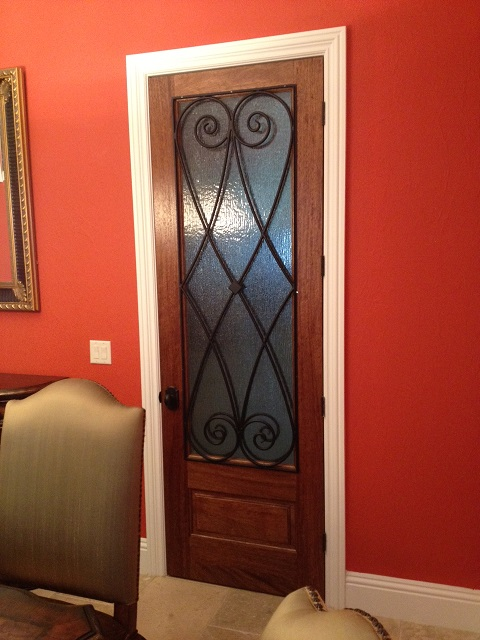 Decorative wrought iron interior doors have dramatic style