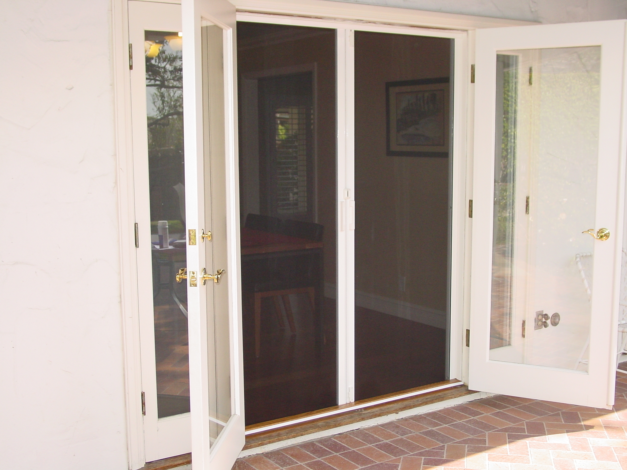 Exterior of French doors with built in screens can be decorated