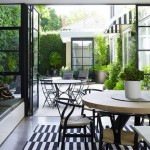 : Exterior patio double doors visually expand indoor space