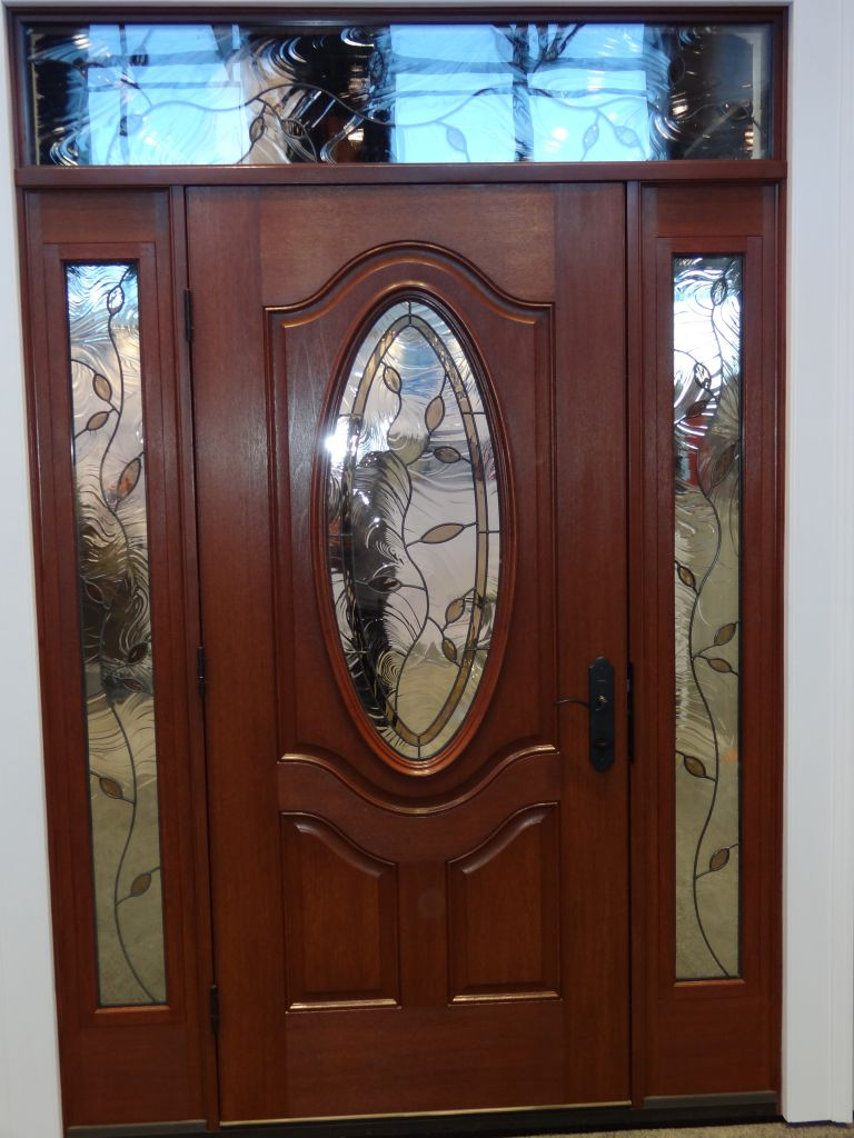 Fiberglass exterior doors can be accomplished with sidelights and transom