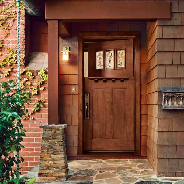 Fiberglass exterior doors that look like wood are a good solution