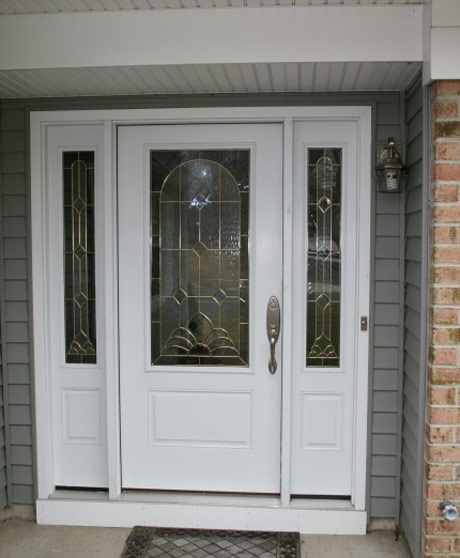 exterior fiberglass front entry door reflects the garden interior