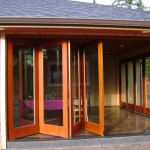 : Folding exterior wood doors enlarge the entrance sufficiently