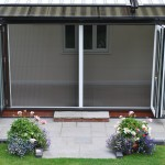 : Folding patio doors with insect screen protect from mosquitoes and flies very well