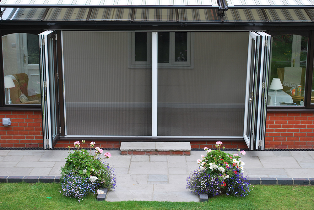 Folding Patio Doors With Insect Screen Protect From Mosquitoes And Flies  Very Well