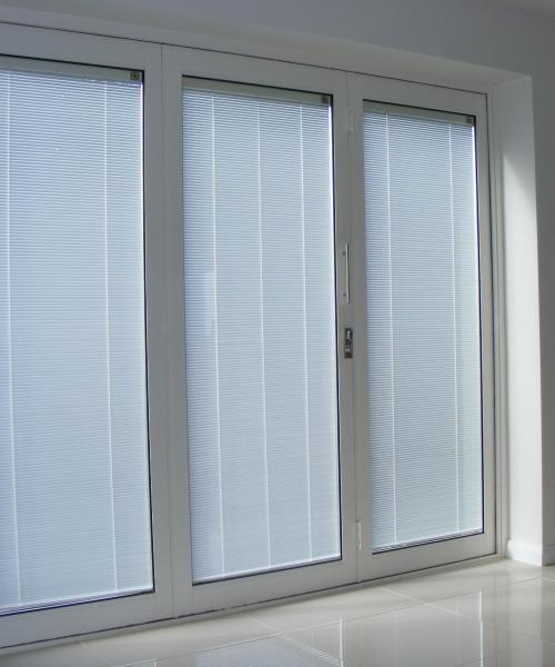 Folding patio doors with integral blinds help to regulate getting of sunlight