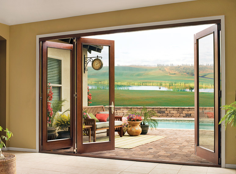 Folding patio doors with screens are made according to space saving techniques