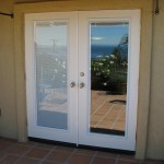 : French exterior doors with built in blinds help to hide the interior