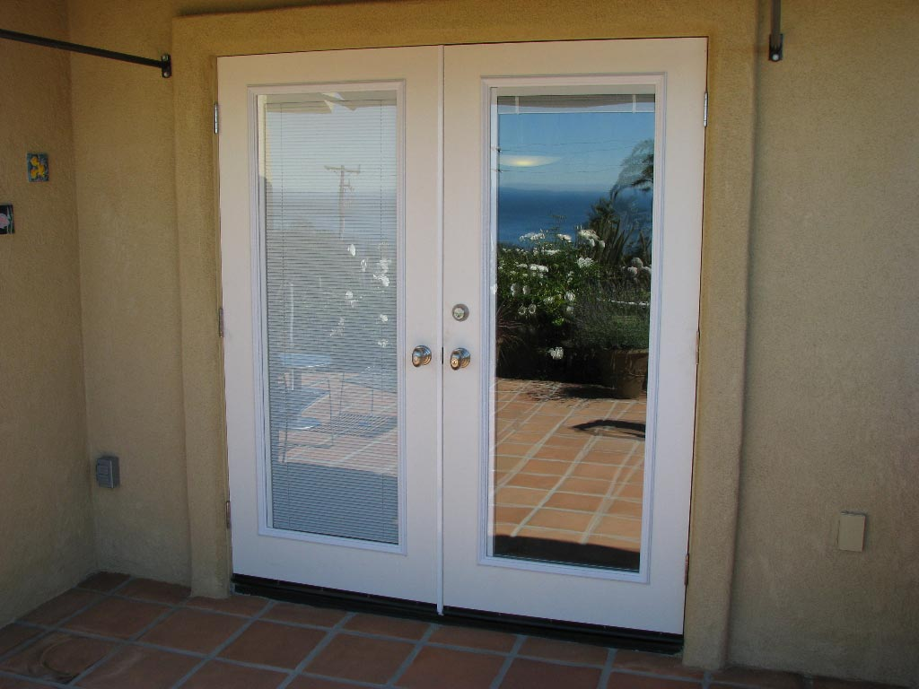French exterior doors with built in blinds help to hide the interior