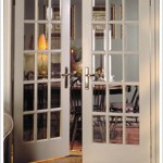 : French front doors with glass inserts have very pleasant appearance