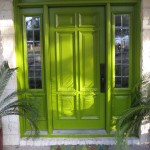 : Front door with sidelights of bright colors creates a festive atmosphere