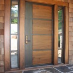 Front doors for a mid century modern home have iron inserts