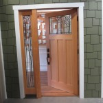 : Front doors for a ranch style home is made of wood