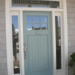 : Front doors for ranch style home is made of solid wood