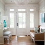 Front entry door with sidelights and transom adds stylish appearance to a house