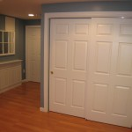 : Hanging sliding wooden door is a good choice for closet