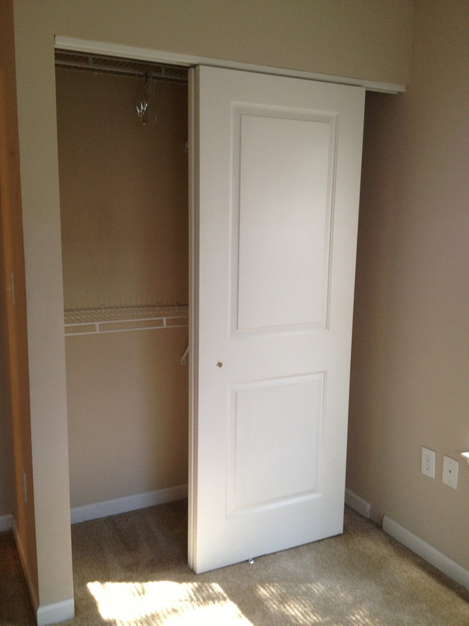 Hanging wood sliding doors are a common solution for closets