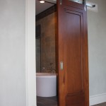 : Indoor hanging sliding doors are appropriate for a bathroom
