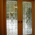 : Interior French doors with decorative glass is a good solution