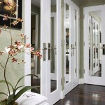 : Interior French doors with glass panels visibly enlarge the space