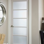: Interior French doors with tempered glass are bright