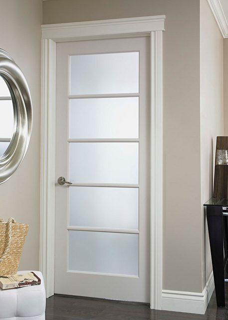 Interior French doors with tempered glass are bright