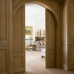 : Interior arched pocket doors are gorgeous