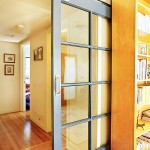 Interior glass door with sidelight gives addition lightening to the place