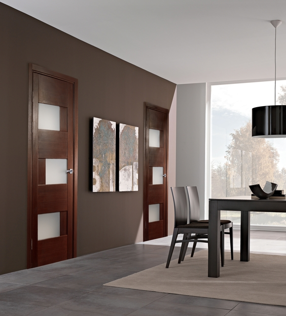 Interior oak doors with glass provide the possibility to view the other room