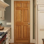 : Interior oak doors with white trim are elegant