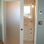 : Interior pocket doors with glass panels look modern