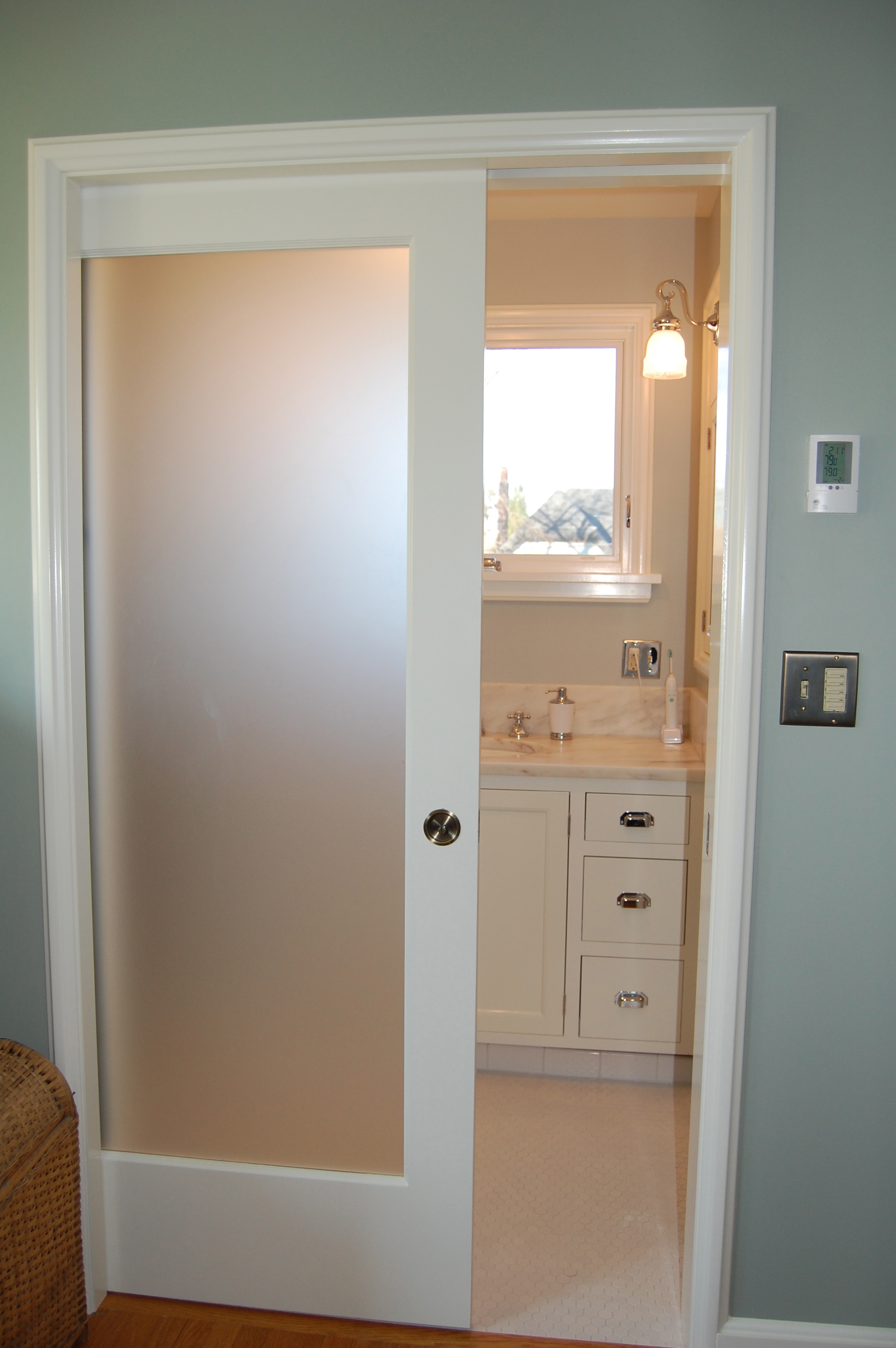 Interior pocket doors with glass panels look modern
