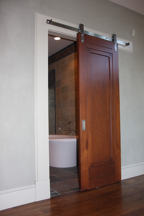 Interior roll up wood door can be installed in your large home bar