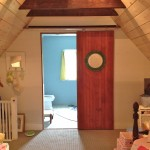 : Interior wood roll up door are chosen for additional home decor