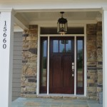 : Light craftsman style front doors make any house look bigger and wealthier