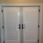 : Louvered interior doors may possess white color scheme