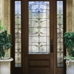 : Round top wood storm doors look so cute when decorated with real plant vines